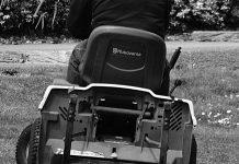 A man riding a Husqvarna mower