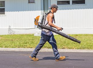 A man using a backpack leaf blower