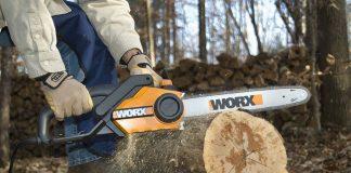 Electric chainsaw cutting wood