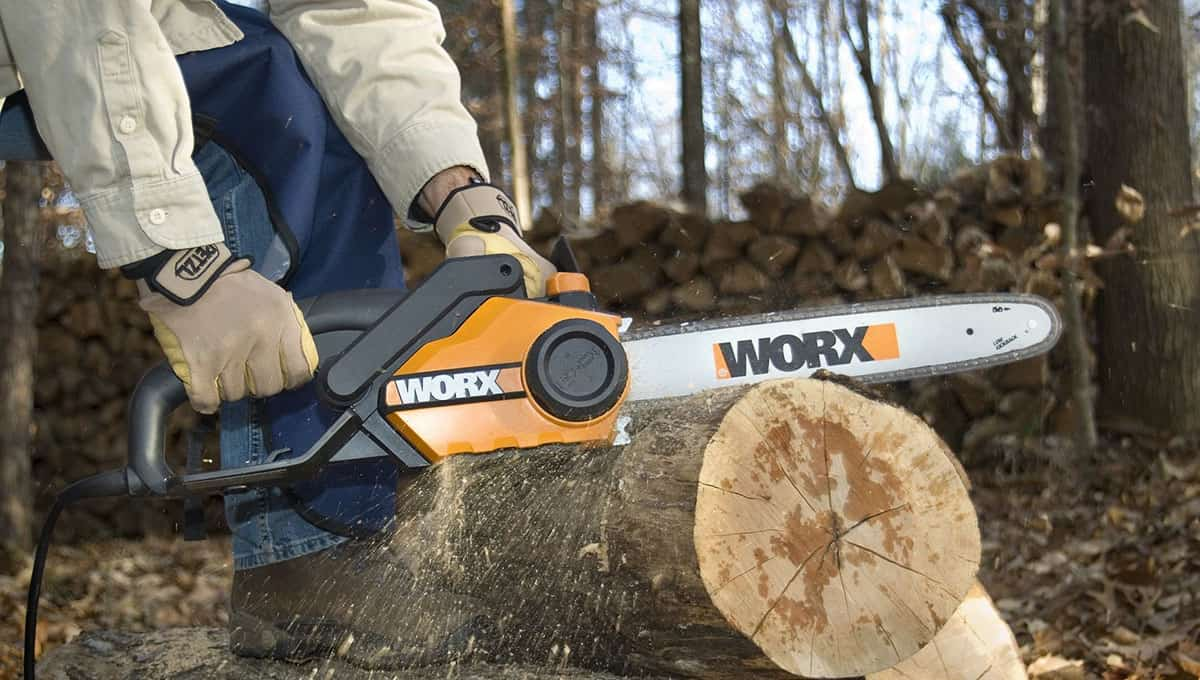 Electric chainsaw cutting wood