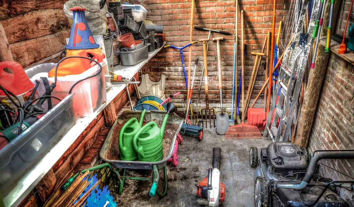 A shed full of gardening tools that have seen a lot of usage.