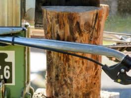 A man using an electric log splitter
