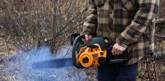 This chainsaw is malfunctioning, emitting smoke while running.